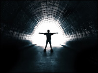 Person standing in a tunnel of light